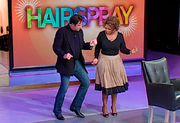 John Travolta dances with Oprah.
