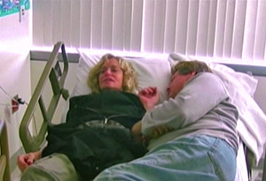 Farrah Fawcett and Ryan O'Neal in her hospital bed