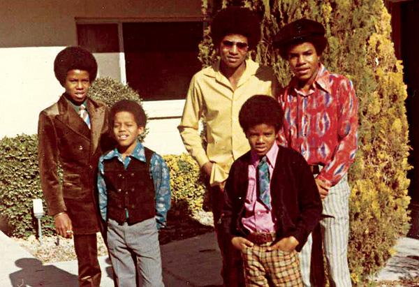 Jackson boys outside their home