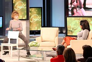Jane Fonda demonstrating exercises for Oprah