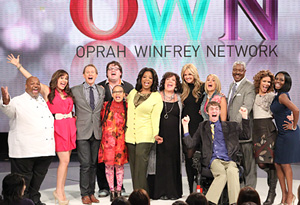 Oprah with the hosts and contestants of Your OWN Show