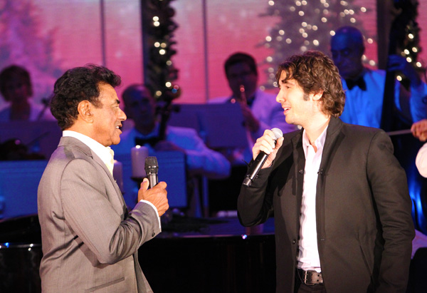 Singers Johnny Mathis and Josh Groban singing a duet