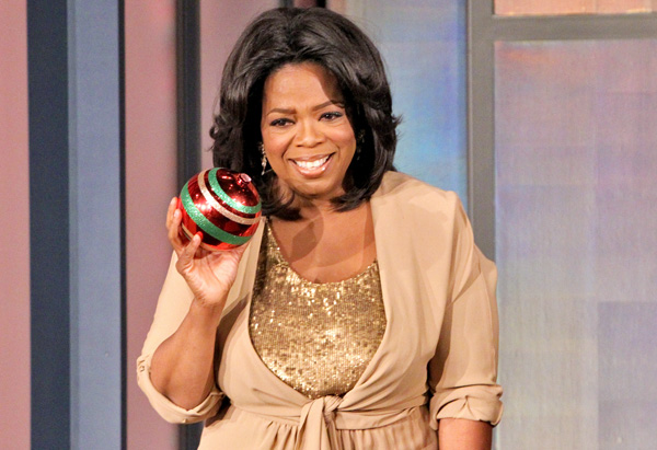 Oprah holding a Christmas ornament