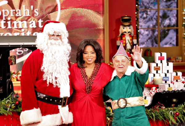 Oprah with Santa and his elf.