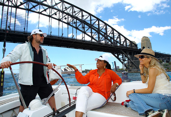 Russell Crowe, Danielle Spencer and Oprah sail the Sydney Harbour.
