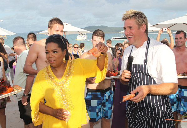 Oprah throws a shrimp on the barbie.