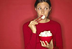 Woman eating tofu