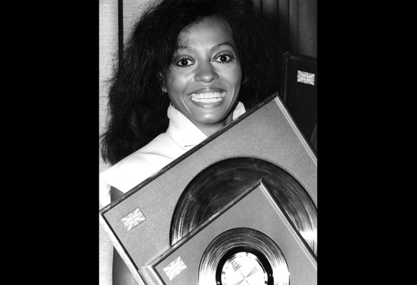 Diana Ross holding discs in 1980