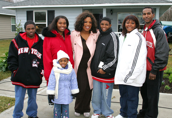 Oprah in front of a Katrina home