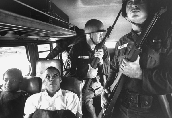Freedom Riders on bus with police