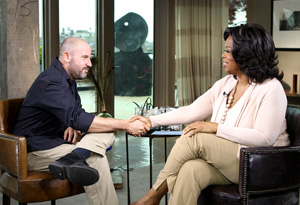 James Frey shaking hands with Oprah