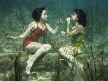Applying lipstick underwater in the 1940s.