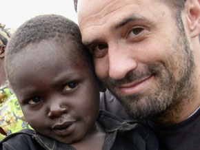 Barton Brooks and a child from Uganda