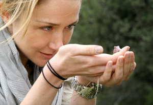 Alexandra Cousteau finds a frog along the Okavango Delta in Botswana.