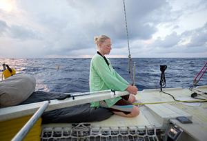 Skipper Jo Royle steers the Plastiki.