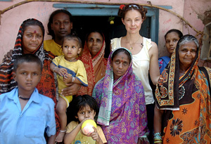 Ashley Judd with a group of women and children in India
