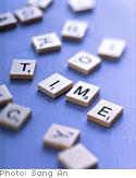 Letter game tiles spelling 'TIME'