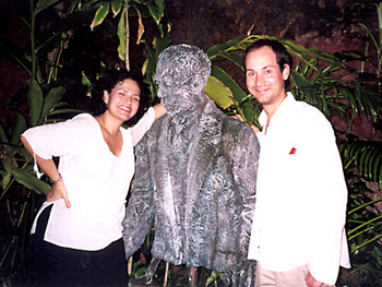 Rebecca and Nathaniel with statue