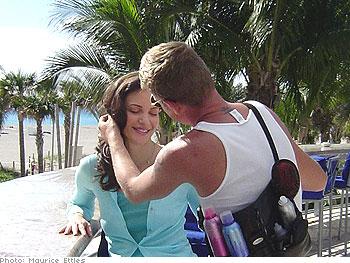 Hairstylist Julian Johnson works on Claudia's long locks