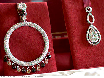 A large hoop dripping with diamonds and an elegant double teardrop