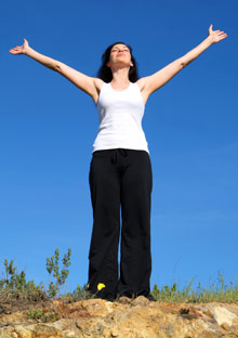 Woman raising her arms to the sky