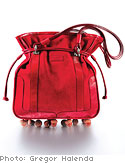 Red drawstring pouch by Kate Spade