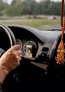Sally Goodrich's dashboard with Afghan prayer beads and photo of her son Peter