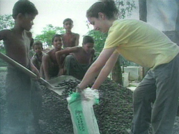 Volunteers help build a school in India.
